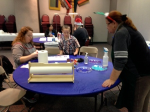 Susan Murray assisting with creating wrapping papr